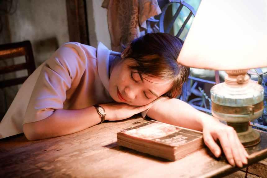 book girl indoors lampshade